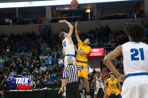 6'3 Harley Upton of Alchesay jumps against 6'8 Jared Perry of Paradise Honors to start the 2A State Semifinals at the Prescott Valley Events Center. The Falcons upset PH 67-61.