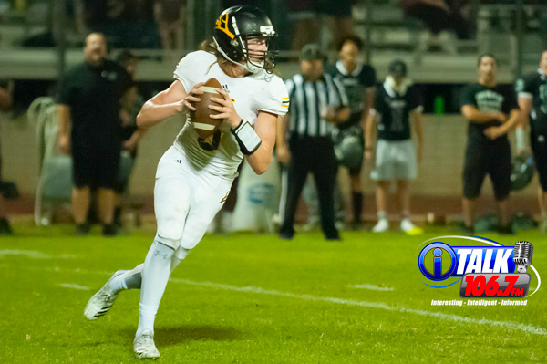 Round Valley Quarterback Kason Woolf drops back to pass during the Elks overtime victory (28-21) over the Cougars of Phoenix Christian High School on September 21st, 2018
