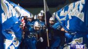 The Snowflake Lobos Football Team enter the field.