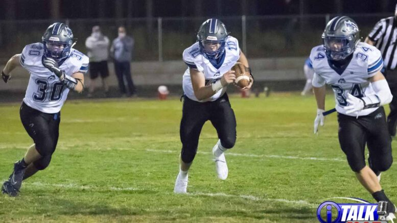 #10 Caden Cantrel carried the football in the Snowflake Lobos 22-21 win over the Blue Ridge Yellow Jackets 10-16-2020. #30 Terren Green and #34 Mayson McKinlay provide blocking.