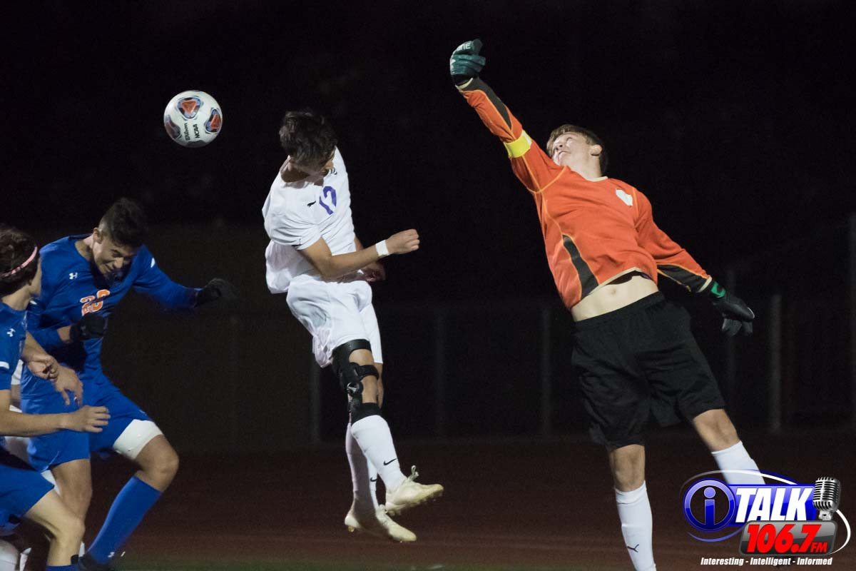Blue Ridge Defender Jackie Belnap and Keeper Andrew Plath Elevate to Clear a Corner Kick out of the Box.  2020 2A State Soccer Championship Game.