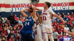 Snowflake Forward (#24) Stewart West attempts a shot against Holbrook's (#44) Ethan Bahe and (#11) Kobi Koerperich during a 2019 -2020 3A High School Basketball game at Holbrook, AZ.